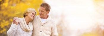 Elderly couple taking a walk in the fall